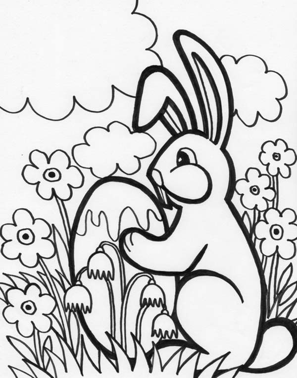 Little Bunny Holding An Easter Egg Coloring Page