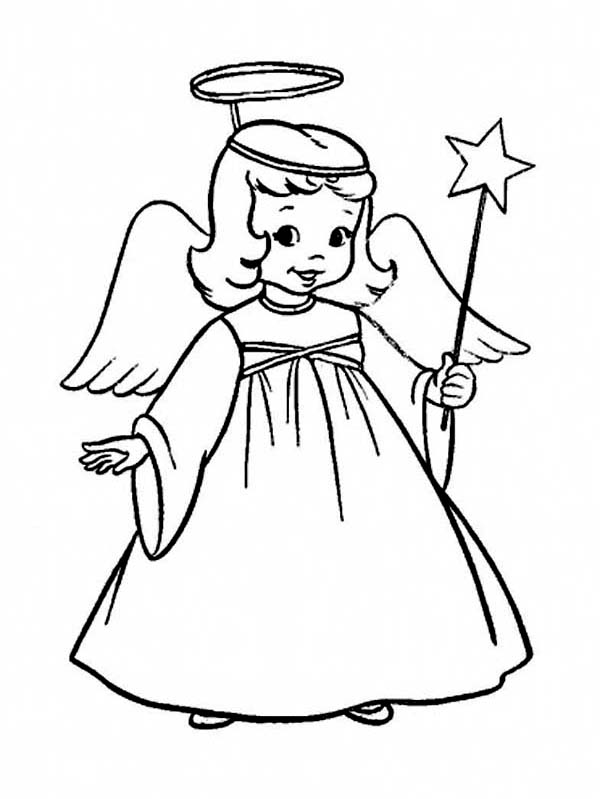 A Charming Little Girl in Angel Costume on Christmas ...
